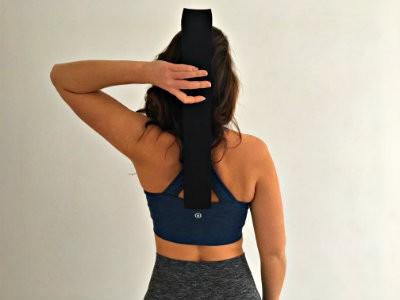 hoe gebruik je een yoga strip gevouwen op rug